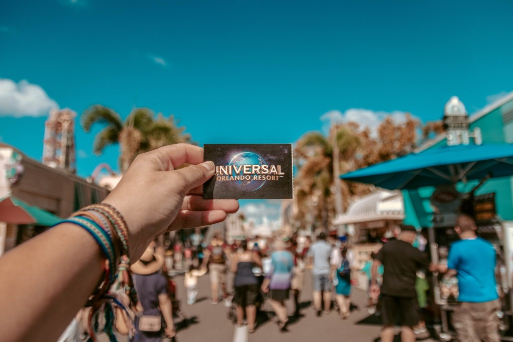 Person Holding Universal Studios Ticket 1860618