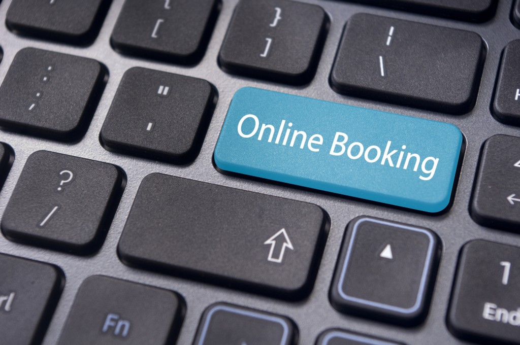 Online,booking,concepts,,with,message,on,enter,key,of,computer